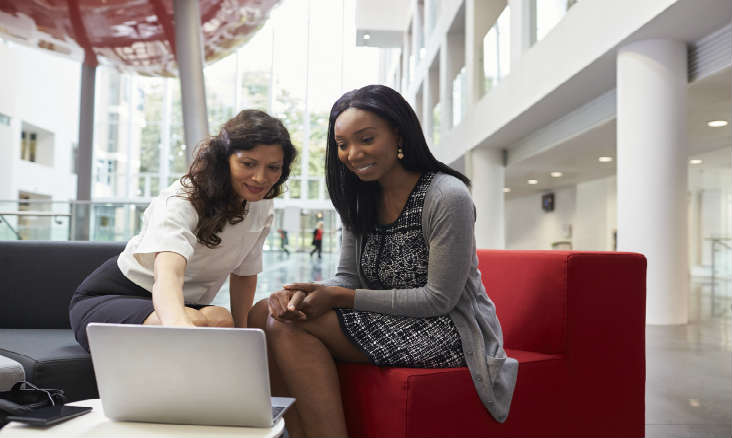 A woman giving mentoring advice in the workplace