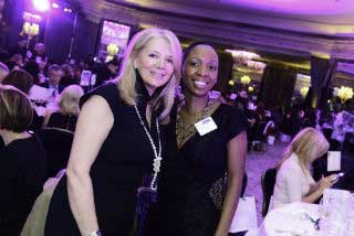 Two women attendees of the NatWest everywoman Awards posing for a photograph at their table