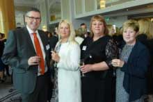 A man standing with a group of women at the FTA awards ceremony