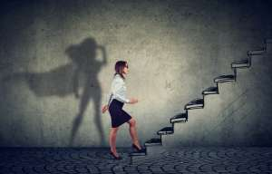 Business woman climbing stairs
